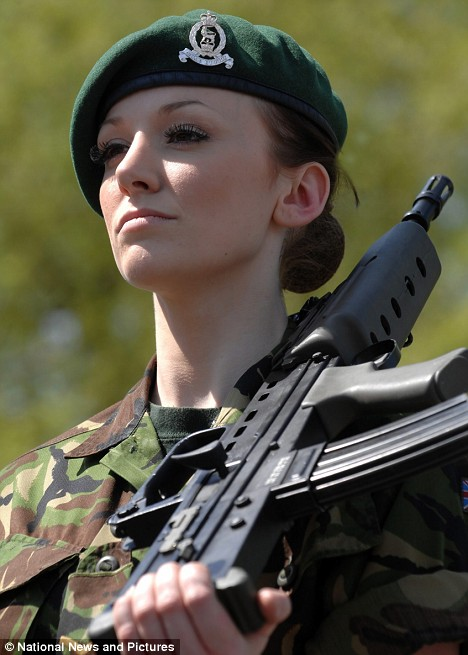 Lance Corporal Katrina Hodges on duty in her camouflage gear