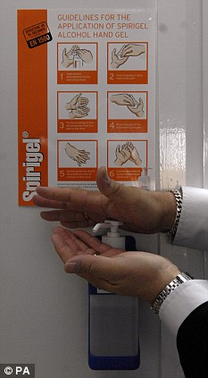 A member of staff at Mile End Hospital's anti-viral collection point uses a alcohol hand gel