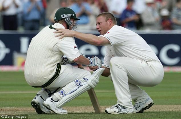 Andrew Flintoff of England consoles Brett Lee of Australia after England defeated Australia