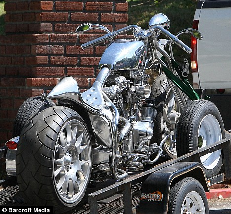 That doesn't look comfy: A customised chrome motorcycle was delivered to Brad Pitt's Hollywood home today