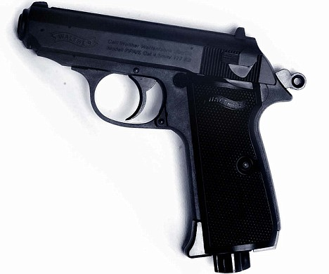 Mr Button admitted leaving a Walther PPK, pictured, with his father and returning to the hospital with ammunition the same day