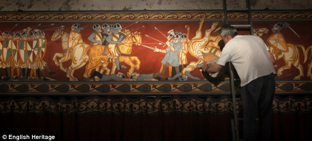 Restoration: Set designer Kit Surrey puts finishing touches to an 180-foot long wall hanging depicting the Norman Conquest, the design of which is inspired by the Bayeux Tapestry