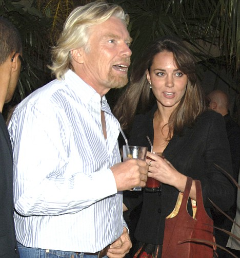 Business relationship: Kate Middleton speaks to Richard Branson at a party; the two have had a series of meetings