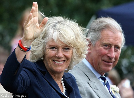 Blow: Prince Charles with Camilla Parker Bowles at the Sandringham Flower Show in June