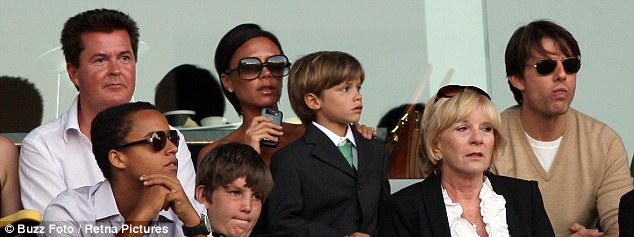 Simon Fuller, Victoria Beckham, son Romeo and Tom Cruise watch David Beckham from the stands