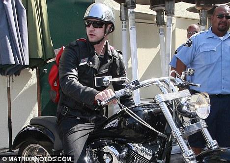 Singer Justin Timberlake seen hopping on his motorcycle
