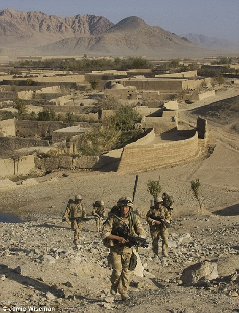 Tough terrain: Royal marine commandos on patrol in Helmand province