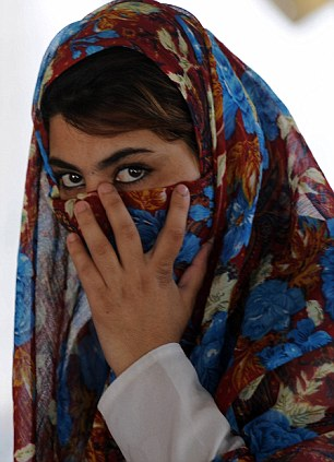 An Afghan female voter looks as she waits to cast her vote at a polling centre in Kandahar