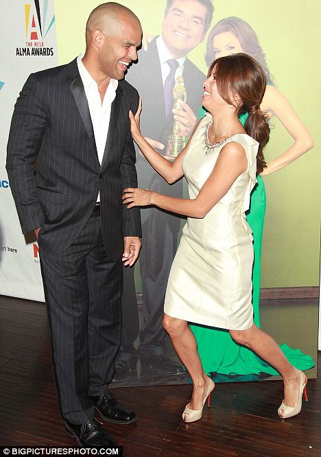 What a joker: Eva poses with actor Amaury Nolasco at the launch