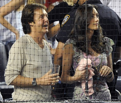 Paul McCartney and MTA Board member Nancy Shevell stand for the seventh inning between the New York Yankees and the Texas Rangers at Yankee Stadium