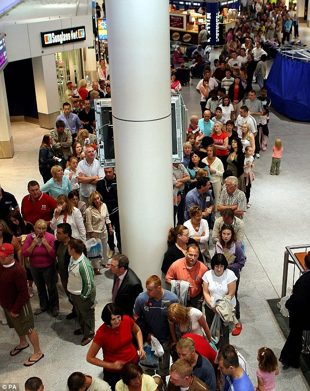 Queuing misery: This picture of passengers waiting to check in at Manchester airport was taken on August 10 2006