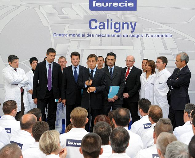 The specially chosen group listen intently as President Sarkozy speaks