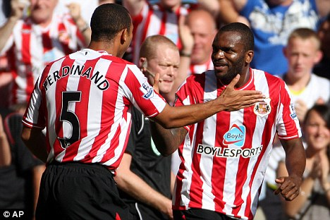 Sunderland's Darren Bent, right, reacts after scoring a goal with fellow team member Anton Ferdinand