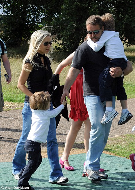 Remorseful: Russell, here with his wife Danielle Spencer and their sons Charles and Tennyson at Kensington Gardens to see Peter Pan, admits his past behaviour put his family through 'terrible times'