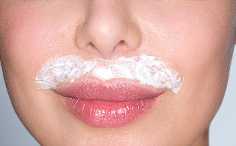 Liz Jones first began bleaching her lip before a trip to the beach when she was just 13 (posed by model)