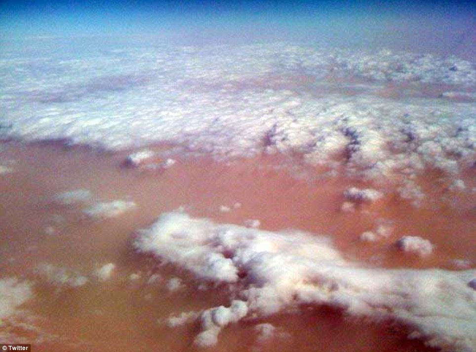 From the air: An airline passenger took this photo of the dust blanketing Sydney