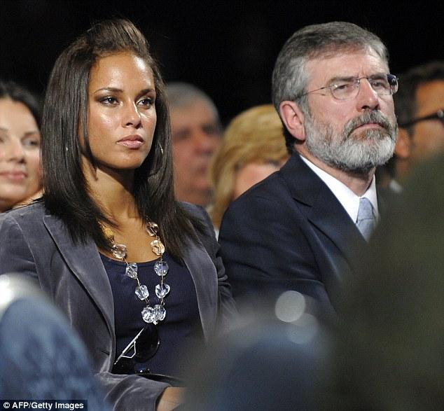 Alicia Keys (C) and Sinn Fein President Gerry Adams