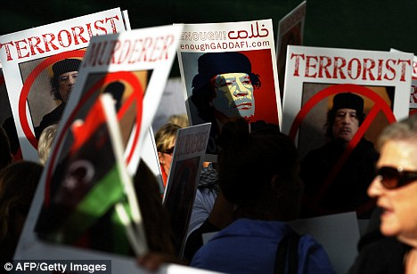 Protests: Demonstrators shout slogans against Gaddafi oustide the UN today