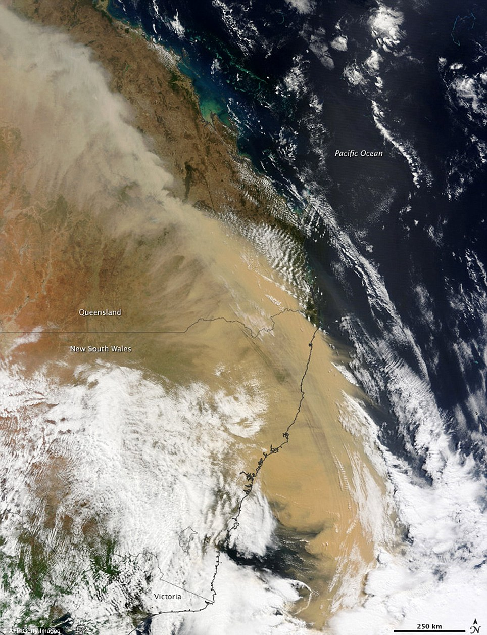 Visible from space: A beige wall of dust can be seen stretching over Queensland and out to see in this Nasa image taken yesterday