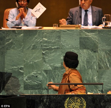 Muammar Gaddafi literally throws the book at the Deputy Secretary General and President of the General Assembly during his speech to the 64th General Debate of the United Nations