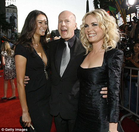 Cast member Bruce Willis poses with his girlfriend Emma Heming (L) and co-star Radha Mitchell