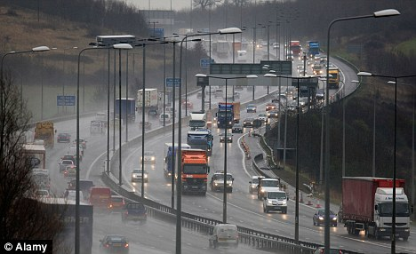 Heavy traffic on the M25 in Essex. Under a controversial scheme cars would be fitted with electronic tags and charged at times of peak congestion