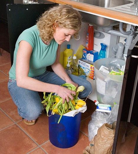 Woman sifts through bins