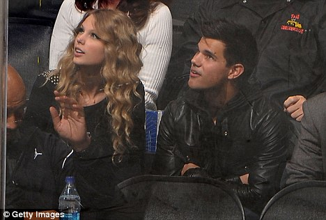 Taylor Lautner and Taylor Swift attend the NHL game between the Columbus Blue Jackets and the Los Angeles Kings Staples Center
