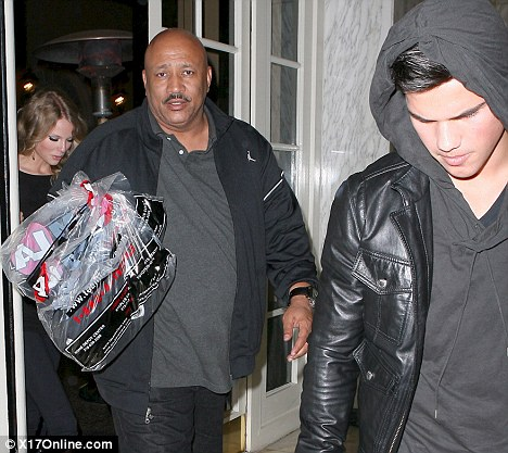 Taylor Swift and Taylor Lautner leaving the Beverly Wilshire Hotel