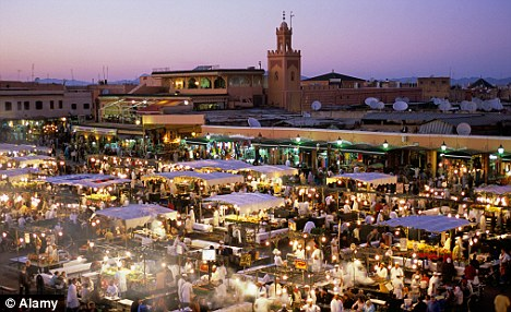 Market and food stalls on Djemaa El Fna square at evening city of Marrakech,  Morocco