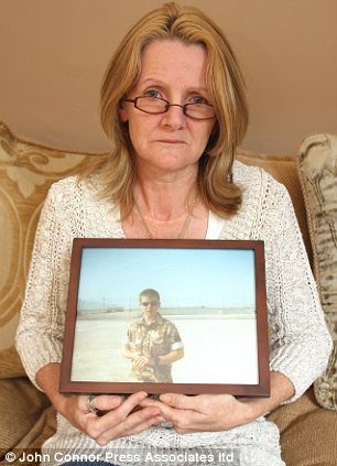 Jacqui Janes holding a photo of her son Jamie