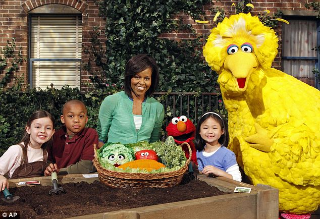 A-OK: Michelle Obama appears with Big Bird, Elmo, and some of the child actors on Sesame Street in 2009