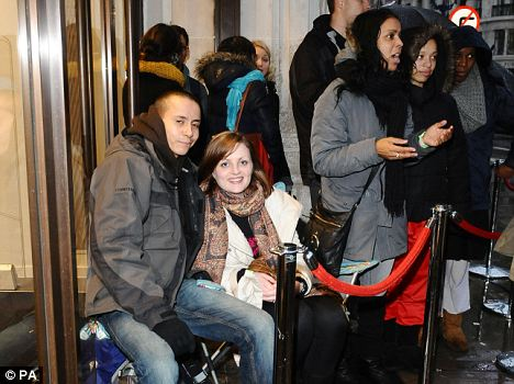 Military operation: Will Cubberley and girlfriend Kate Smith at the front of the queue yesterday at H&M Regent Street