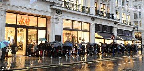 Jimmy queues: A line snaked around the block from the H&M store in Regent Street as shoppers braved the rain yesterday morning