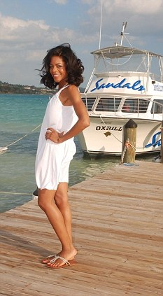 Naomie Harris is pictured on a jetty in front of the Sandals yacht