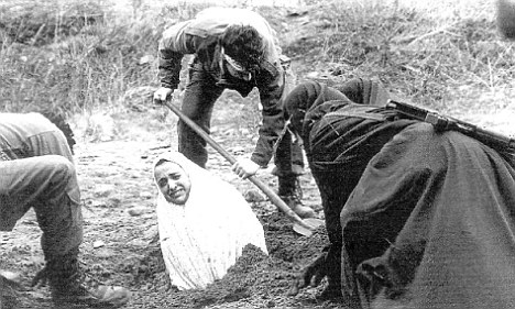A woman is pictured being prepared for stoning in Iran (file photo). The woman stoned in Somali would have been buried in the same way