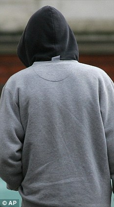 The back of a person wearing a hoodie
