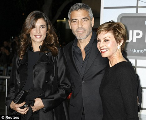 """George Clooney star of the film """"Up In The Air"""" poses with girlfriend Elisabetta Canalis (L) and his mother Nina Clooney"""