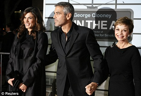 """George Clooney, star of the film """"Up In The Air"""", poses with girlfriend Elisabetta Canalis (L) and his mother Nina Clooney"""