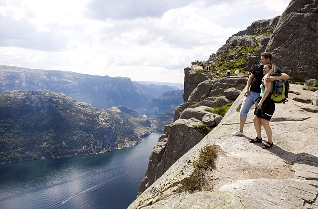 High and mighty: The Preikestolen Rock at 600m above the Lysebotn Fjord