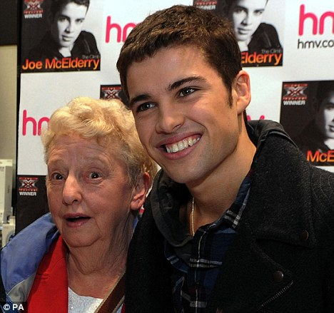 Homecoming: X Factor winner Joe McElderry with his grandma, Hilda, during a signing for his debut single The Climb in South Shields