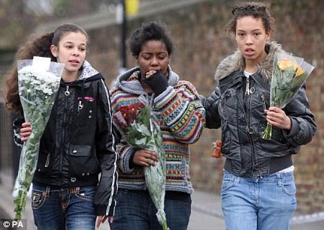 Girls arrive with flowers at Mr Kombo's murder scene