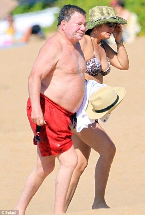 The waistband cannae take it, Captain: William Shatner and his wife Elizabeth soak up the sun in Hawaii