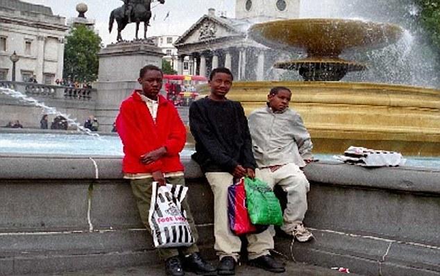 Trafalgur trip: Again in the red jacket, Umar Farouk Abdulmutallab outside another London landmark