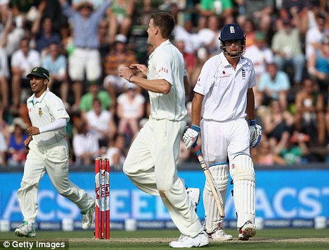 Alastair Cook of England looks dejected as he walks off after losing his wicket to Morne Morkel