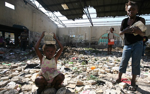 Two young girls helping with the removal of debris at what used to be the Petionville market in Port-au-Prince