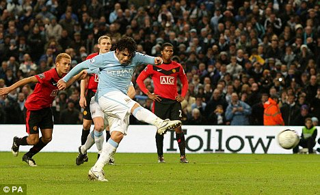 Smashed home: Tevez fires an unstoppable penalty to level the game for City