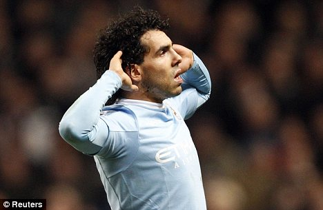 Ear we go: Tevez sends the United a message after scoring his second