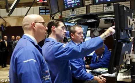 Market plunge: Traders on the floor of the New York Stock Exchange shortly before the closing bell this morning