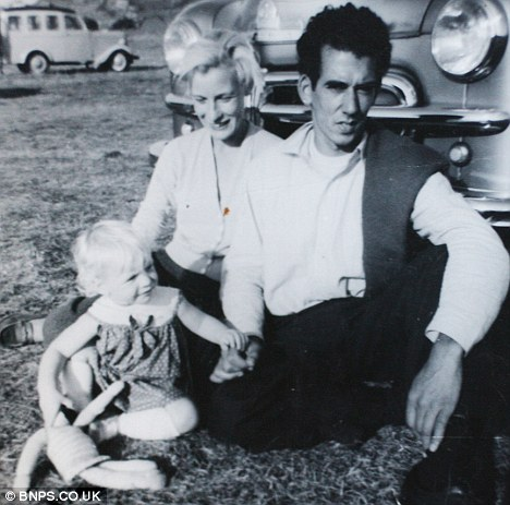 Frances Simpson kept this picture of herself as an 18-month-old toddler with her father and mother